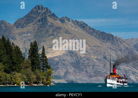 New Zealand, South Island, Otago, Queenstown, The Remarkables Mountains with the steamer TSS Earnslaw - Stock Photo
