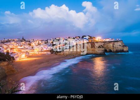Carvoeiro, Lagoa, Algarve, Portugal. City lights at dusk. - Stock Photo