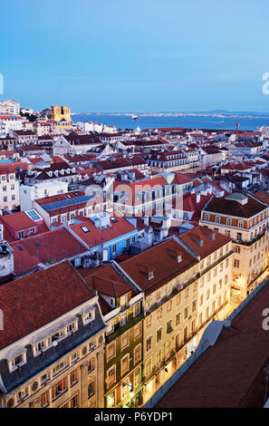 Rooftops of the Baixa, the historic centre of Lisbon, with the Tagus river and the Motherchurch on the background, at twilight. Lisbon, Portugal - Stock Photo
