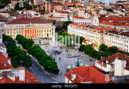 Rossio square or Praca Dom Pedro IV, the heart of the historic centre at twilight. Lisbon, Portugal - Stock Photo