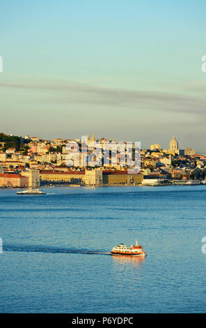 The Tagus river (Tejo river) and the historic centre of Lisbon in the evening. Portugal - Stock Photo