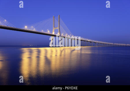 Vasco da Gama Bridge over the Tagus river (Tejo river), the longest bridge in Europe. Lisbon, Portugal - Stock Photo