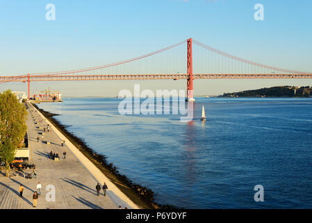 Belem esplanade, along the Tagus river. 25 de Abril bridge on the background. Lisbon, Portugal - Stock Photo
