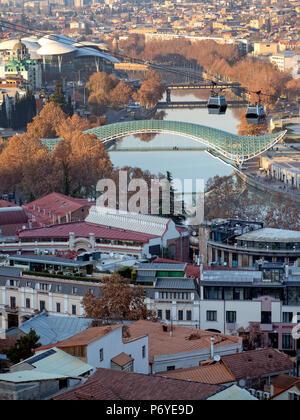 Top view of Bridge of Peace over Mtkvari river and city centre, Tbilisi, Georgia - Stock Photo