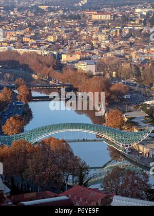 Aerial view of Kura river and Bridge of Peace, Tbilisi cityscape, Georgia - Stock Photo