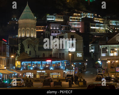 Tbilisi, Georgia - November 28, 2016 : night view of Old Town from Gorgasali square with cafe and restaurants, Saint George cathedral and traditional  - Stock Photo