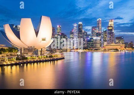 Singapore, Republic of Singapore, Southeast Asia. The ArtScience museum and the city skyscrapers at dusk.