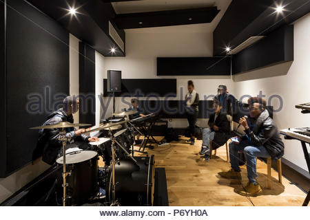 Students practice in music studio. ELAM, London, United Kingdom. Architect: Hunters South, 2018. - Stock Photo