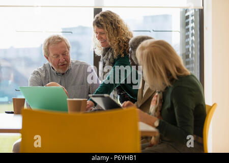 Senior business people in conference room meeting - Stock Photo
