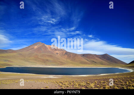 Laguna Miniques or Miniques lake with Cerro Miscanti volcano at the highland of northern Chile - Stock Photo