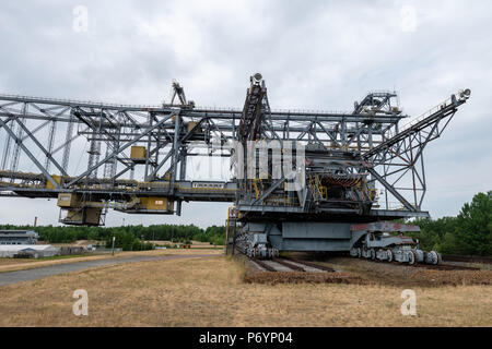 F60 is the series designation of five overburden conveyor bridges used in brown coal (lignite) opencast mining in the Lusatian coalfields in Germany.  - Stock Photo