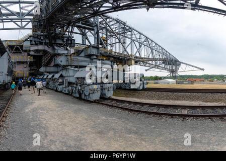 F60 is the series designation of five overburden conveyor bridges used in brown coal (lignite) opencast mining in the Lusatian coalfields in Germany.  - Stock Photo