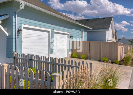 Garages on back side of homes - Stock Photo