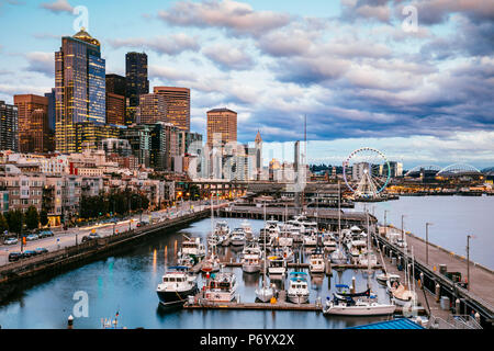 Waterfront and downtown district at sunset, Pier 66, Seattle, Washington, USA - Stock Photo