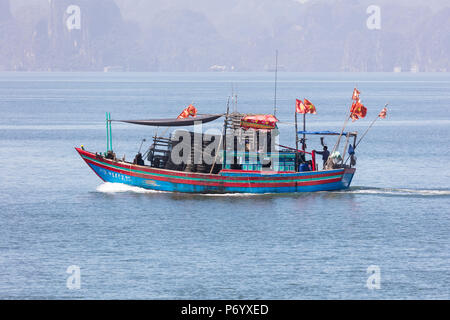 Colourful fishing boat with flags, Halong Bay, Quang Ninh Province, North-East Vietnam, South-East Asia - Stock Photo