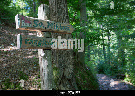 A walkers' footpath uphill towards Saint Michael's church and a lookout tower, on 23rd June 2018, in Celje, Slovenia. - Stock Photo