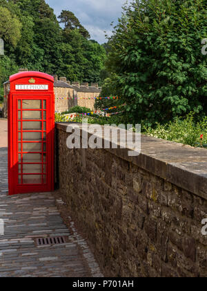 The iconic red British telephone box or kiosk once installed in every town and village with a Post Office is now disappearing from the streets of Brit - Stock Photo