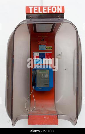 An old public telephone kiosk in the central Slovenian rural town of Kamnik, on 25th June 2018, in Kamnik, Slovenia. - Stock Photo