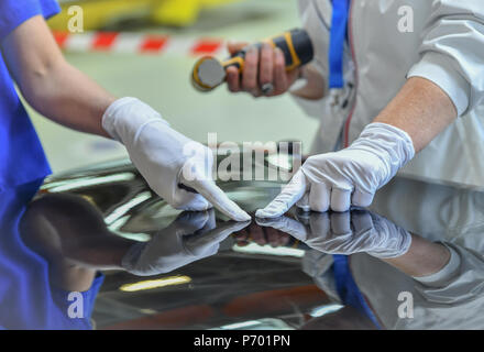 Man holds a polisher in the hand for scratch - Stock Photo
