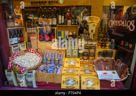Typical products in a shop window. Segovia, Spain. - Stock Photo