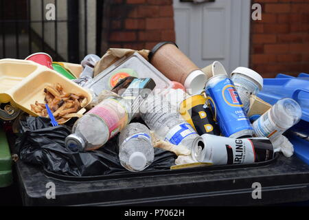 what a load of rubbish in a wheelie bin in manchester - Stock Photo