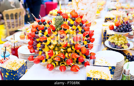 Fresh fruit on skewers - Stock Photo