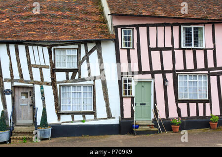 England, Suffolk, Lavenham, Old timber framed cottages in the village. - Stock Photo