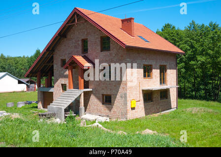 A new build house nearing completion at Kamienica Gorna, South East Poland,Europe. - Stock Photo