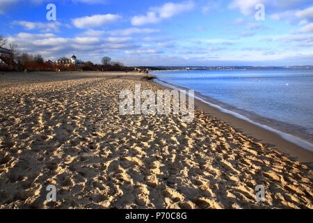 Empty beautiful sandy Baltic beach in northern Europe, Poland, relaxing quiet sandy beach without people, sunny weather, blue sky with nice clouds - Stock Photo