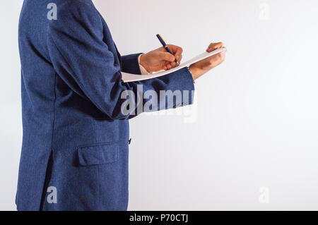 Close-up of businessman written on paper on white background / businessman is writing a letter or signing a agreement. - Stock Photo