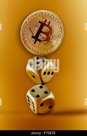 Golden Bitcoin and dice - Stock Photo