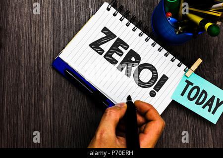 Text sign showing Zero Motivational Call. Conceptual photo The emptiness nothingness of something no value Reminder appointment daily work pens penhol - Stock Photo