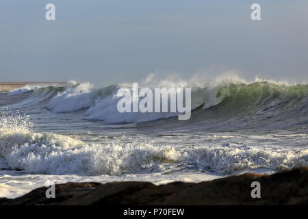 Big waves approaching the portuguese coast. Leca da Palmeira beach, north of Portugal. Surf point. - Stock Photo