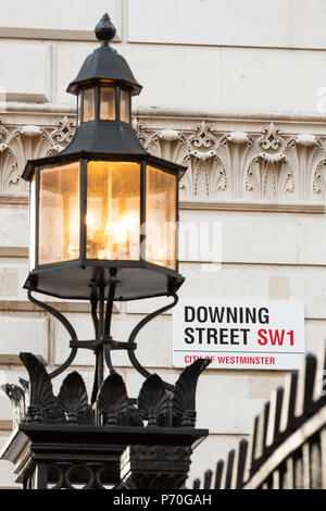 London, UK - 20th November 2013: The iconic sign for Downing Street, Westminster.  Number 10 is the official residence of the Prime Minister. In Londo - Stock Photo