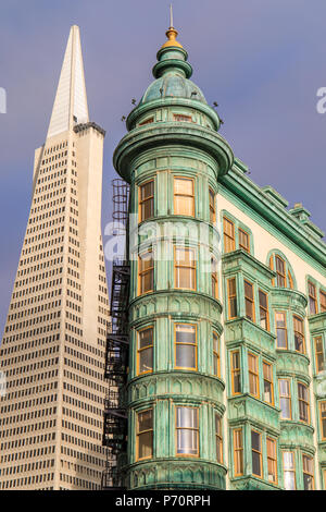 Columbus Tower (aka. the Sentinel Building) and the Transamerica building in the background. Downtown San Francisco, California USA. - Stock Photo