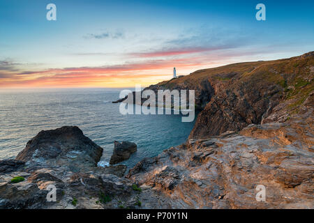 Beautiful sunset over the lighthouse at Trevose Head near Padstow on the rugged Cornwall coast - Stock Photo