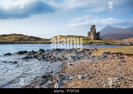 The ruins of Ardvreck Castle on the shores of Loch Assynt - Stock Photo
