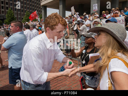 U.S. Democratic Representative Joseph Patrick Kennedy III (Joe Kennedy), grandson of Robert Kennedy and grand-nephew of John F. Kennedy Shaking hands at Boston City Hall during the Rally against Family Separation in Boston, MA. Kennedy had spoken against U.S. President Donald Trump's policy of detaining immigrants and separating immigrant families.  Large rallies against President Trump's policy of separating immigrant families took place in more than 750 U.S. cities on June 30th of 2018. - Stock Photo
