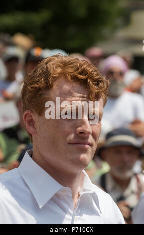 U.S. Democratic Representative Joseph Patrick Kennedy III (Joe Kennedy), grandson of Robert Kennedy and grand-nephew of John F. Kennedy at Boston City Hall during the Rally against Family Separation in Boston, MA. Kennedy had spoken against U.S. President Donald Trump's policy of detaining immigrants and separating immigrant families.  Large rallies against President Trump's policy of separating immigrant families took place in more than 750 U.S. cities on June 30th of 2018. - Stock Photo