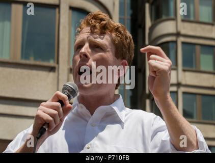 U.S. Democratic Representative Joseph Patrick Kennedy III (Joe Kennedy), grandson of Robert Kennedy and grand-nephew of John F. Kennedy Speaking during the Rally against Family Separation in Boston, MA. Kennedy had spoken against U.S. President Donald Trump's policy of detaining immigrants and separating immigrant families.  Large rallies against U.S. President Trump's policy of separating immigrant families took place in more than 750 U.S. cities on June 30th of 2018. - Stock Photo