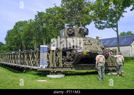 WW2 American M32 Tank Recovery Vehicle on Bailey bridge at Overlord Museum near Omaha Beach, Colleville-sur-Mer, Normandy, France - Stock Photo