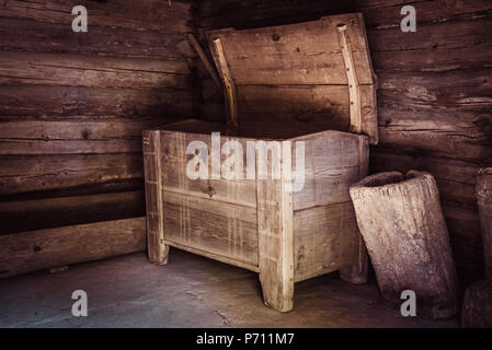 Old vintage wooden chest in some grunge interior - Stock Photo