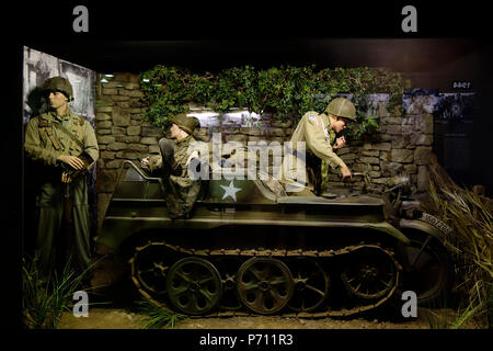 WW2 American soldiers and German Kettenkraftrad HK 101 / Kettenkrad, half-track tractor at the Overlord Museum, Colleville-sur-Mer, Normandy, France - Stock Photo