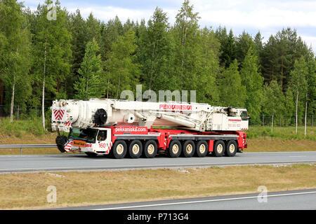 Large Liebherr 8-axle mobile crane of Pekkaniska drives on motorway in summer as wide load. Salo, Finland - June 8, 2018. - Stock Photo