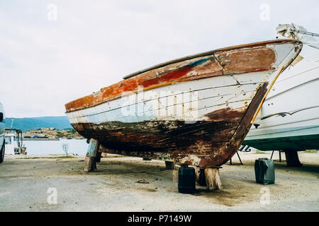 Old boat on land - Stock Photo