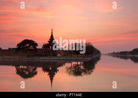 Sunset view of the Royal Palace, City Moat and City Wall in Mandalay, Myanmar (Burma), Asia - Stock Photo