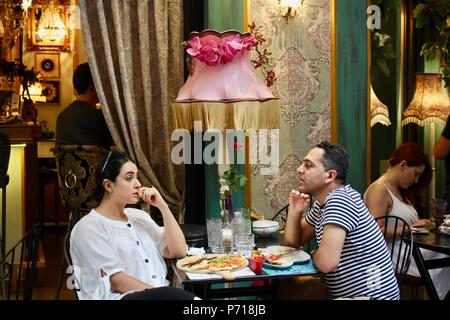 customers at athens bistro tazza in greece with distinctive decor - Stock Photo
