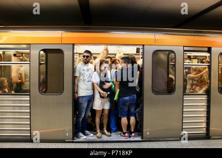 commuters wait on an athens subway train greece - Stock Photo