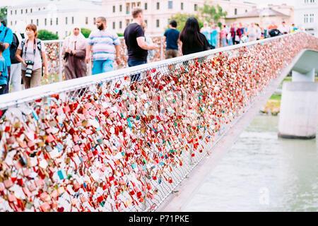 Love locks strapped to Makartsteg Bridge in Salzburg Austria - Stock Photo