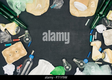 frame of various types of trash on black - Stock Photo